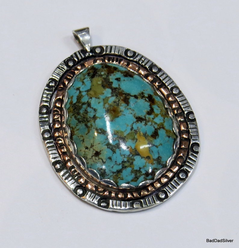 Gem quality natural Fox Turquoise and Stamped Sterling Silver Van Gogh Pendant with copper accent.