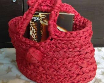 Coral colored crochet handbag