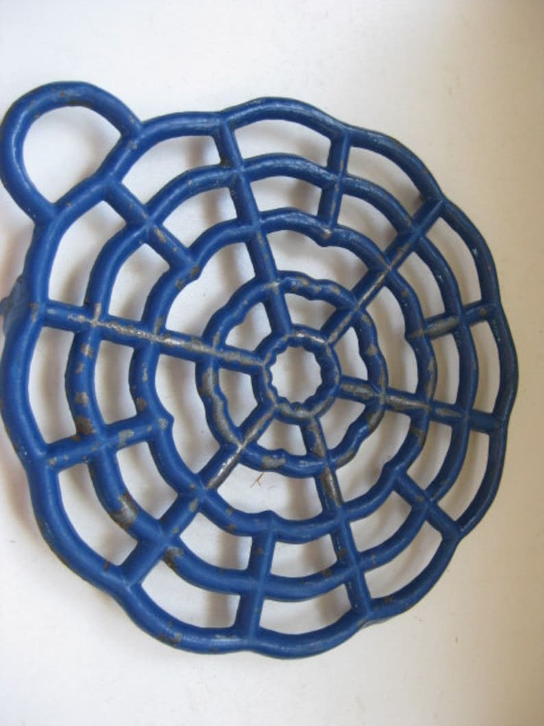 Vintage French cast iron blue colored round table coaster.