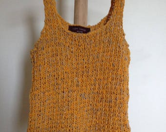 Red knit sleeveless sweater