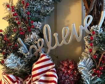 believe holiday grapevine oval wreath winter red white candy cane ribbon wonderland snow tipped pinery pine christmas door hanging decor - Pinery Christmas Trees