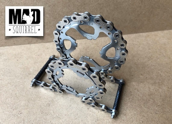Beautiful and unique Campagnolo Chain, Sprockets and Carbon Fibre Tube Letter Rack with a Cyberpunk theme.