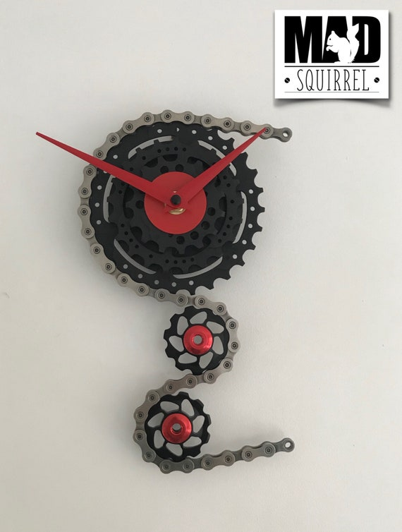 Triple Sprocket and Jockey Wheel Clock, depicting a bike derailleur and cassette, in Black, with Red Hands