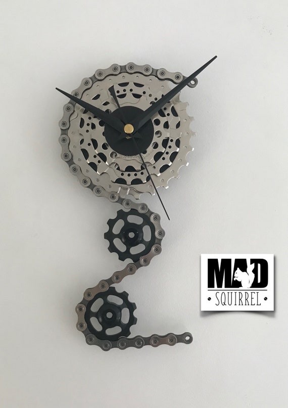 Triple Sprocket and Jockey Wheel Clock, depicting a bike derailleur and cassette, in Silver and Black Face and Black Hands