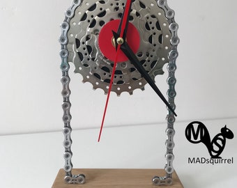 Elegant Floating Sprocket Desk/Shelf Clock with a Triple Sprocket and Red Face with Black and Red Hands and a Polished Chain