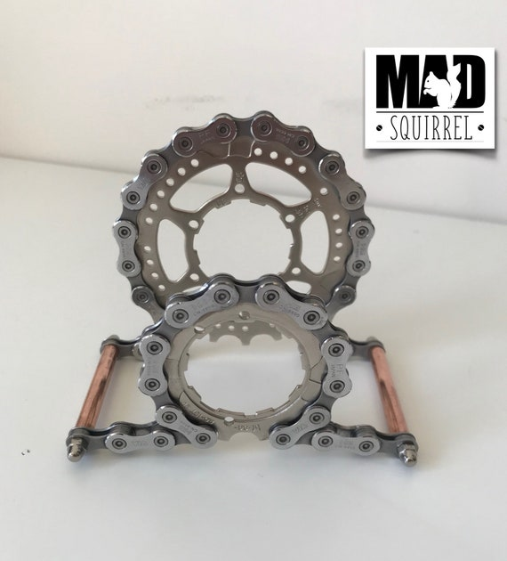 Beautiful and unique Bicycle Chain, Sprockets and Copper Tube Letter Rack with a Steampunk theme.