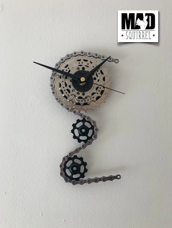Triple Sprocket and Jockey Wheel Clock with a Shimano Ultegra chain, depicting a bike derailleur and cassette and black hands.