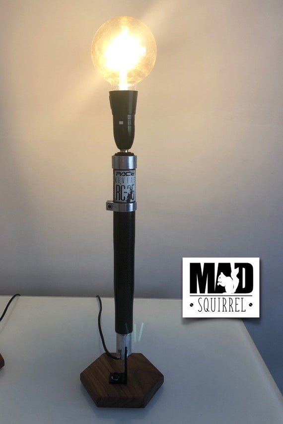 Beautiful Pace RC35 Suspension Folk Lower Leg Lamp, with a Black Walnut Base and Tinted Glode LED Bulb.