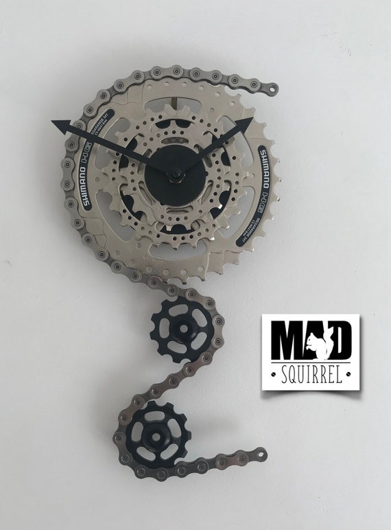 Large Triple Sprocket and Jockey Wheel Clock, depicting a bike derailleur and cassette, in Silver and Gloss Black Face