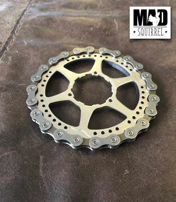 Bicycle Chain and Sprocket Coaster with Protective Ring on the underside.