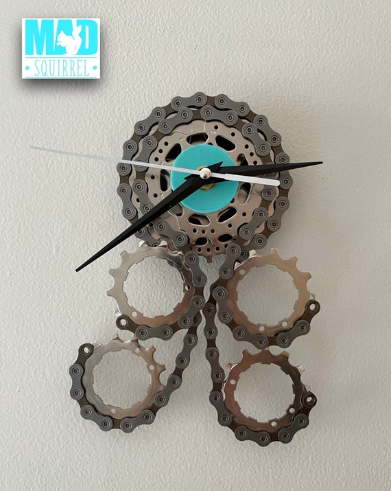 Quadpus Clock, a Sprocket body and 4 chain tentacles, an Ocean Blue Face, Black and White Hands