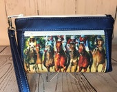 Blue metallic vinyl with thoroughbred racehorses wristlet. Zipper pouch with front zip pocket, double zipper wristlet, clutch, zipper pouch