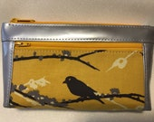 Zipper pouch with front zip pocket, Silver vinyl with grey and gold Bird on a flowering tree branch,  Double zipper clutch purse