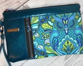 Wristlet purse with vertical front zip pocket, color owl print, blue green glitter vinyl