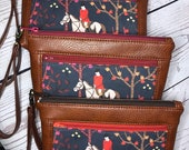 Wristlet purse with front zip pocket, double zipper pouch, foxhunt scene with hounds, chestnut brown soft faux leather, clutch purse