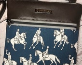 Crossbody bag with dressage horses and riders on dark blue background and chocolate brown faux leather, gunmetal hardware