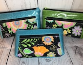 Wrislet or clutch purse, Zipper pouch with front zip pocket, funky floral print and glitter vinyl, clutch or add on wristlet strap