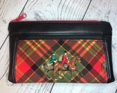 Black faux leather with foxhunt horses and riders on red plaid. Zipper pouch with front zip pocket, double zipper clutch