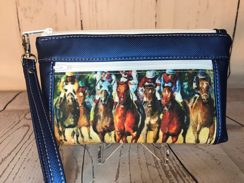 Blue metallic vinyl with thoroughbred racehorses wristlet. image 0