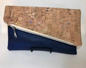 Cork foldover clutch dark blue cork and natural cork with rainbow metallic details, waterproof canvas lining. Vegan and eco friendly.