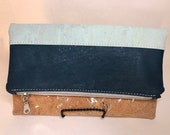 Cork foldover clutch dark teal, mint and silver detailed root cork, waterproof canvas lining. Vegan and eco friendly.