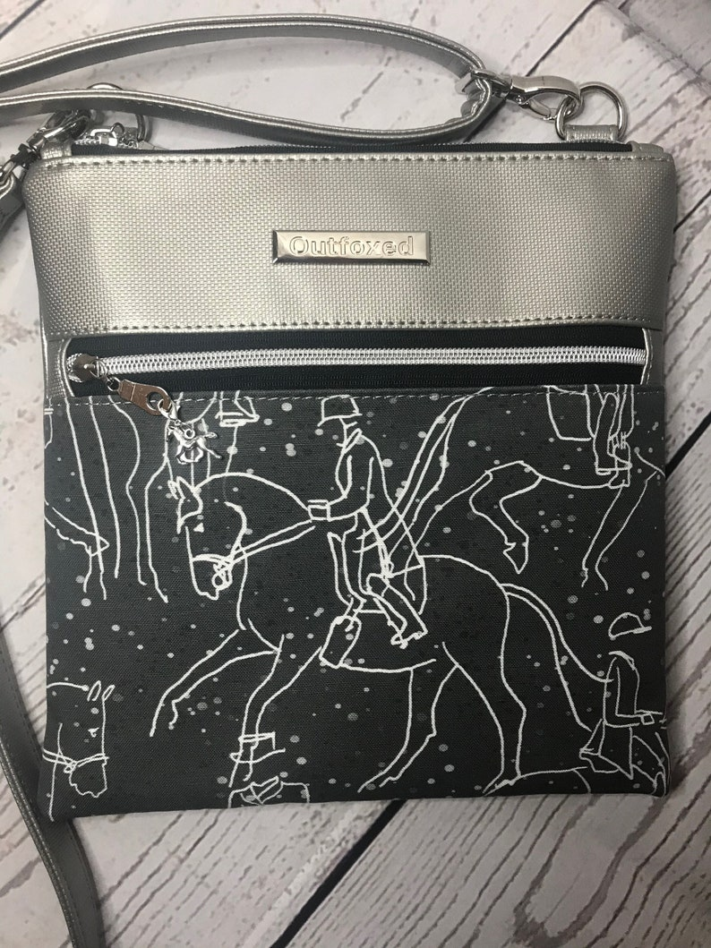 Crossbody bag with dressage scene on black and platinum image 0