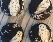 SET OF FOUR Fabric covered button magnets - snowy owl with flowers on black magnets 1 1/8 inch diameter