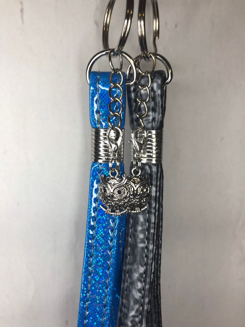 Silver Keychain with faux leather or vinyl wristlet and silver image 0