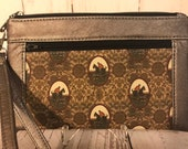 Rose smoke faux leather with foxhunt horses and riders equestrian wristlet. Zipper pouch with front zip pocket, double zipper wristlet