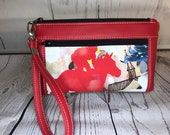 Red vinyl with thoroughbred racehorse wristlet. Zipper pouch with front zip pocket, double zipper wristlet, clutch, zipper pouch