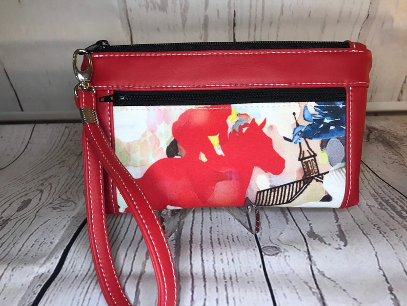 Red vinyl with thoroughbred racehorse wristlet. Zipper pouch image 0