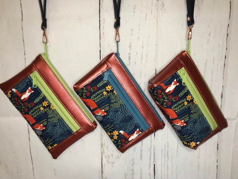 Metallic Rust faux leather wristlet with foxes in a forest  3 image 0