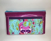 Awesome raccoon print bag with hot pink glitter vinyl. Zipper pouch with front zip pocket, double zipper clutch