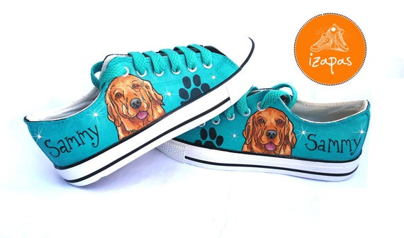 Pair of teal coloured sneakers hand-painted with a Golden Retriever on the sides.