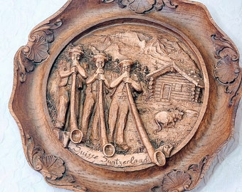 """Vintage Wood Resin 3D Carved Suisse Switzerland Wall Plaque ~ Alphorn Trio Blowing Swiss Horns w/ Log Cabin Swiss Alps Background 9.25"""""""