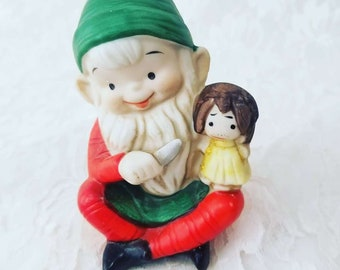 Santa's Elf Gnome Fairy Boy Ceramic Figurine ~ Holding a Knife with a Doll ~ Christmas Decor ~ Holiday Decor Decoration ~ Creepy Christmas