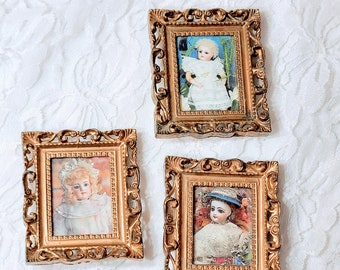"""Set of Three (3) Miniature Doll Sized Framed Antique Doll Pictures ~ Ornate Gold Table Display Picture Frames 2.5"""" x 2.25"""" Sold AS-IS"""