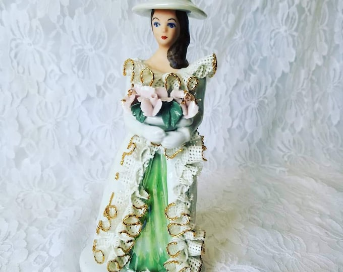 """Vintage ATELIER ROMANIA Lady Holding Flowers 7"""" Figurine ~ Hand Painted ~ White Dresden Lace ~ Good Condition ~ Signed on Bottom"""