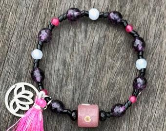Black and purple beaded bracelet with pink lampwork bead