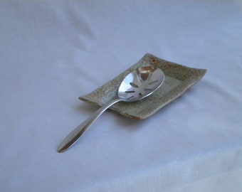 Light green and brown stoneware doily spoon rest
