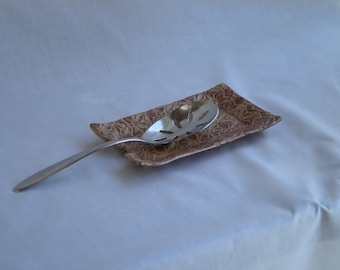 Brown toned stoneware doily spoon rest