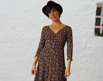 VIONNET  V shape knotted neckline Midi length 3/4 sleeves dress Loose bias cut prewashed 100% viscose crèpe  Black Millefleur print Back zip