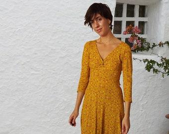 VIONNET V shape knotted neckline Midi length 3/4 sleeve dress Loose bias cut prewashed 100% viscose crèpe Saffron Millefleur print Back Zip