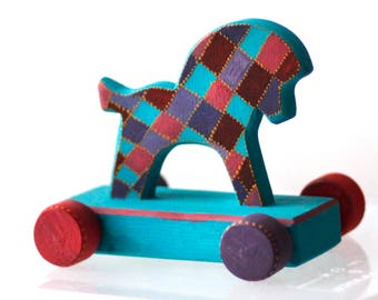 Wooden horse on wheels. Vintage wooden toy, home decor