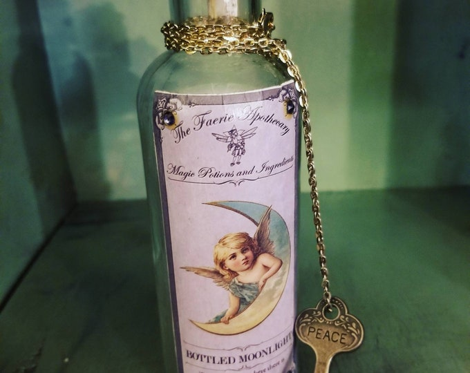The Fairie apothecary bottled moonlight with peace key and Swarovski highlights corked apothecary bottle