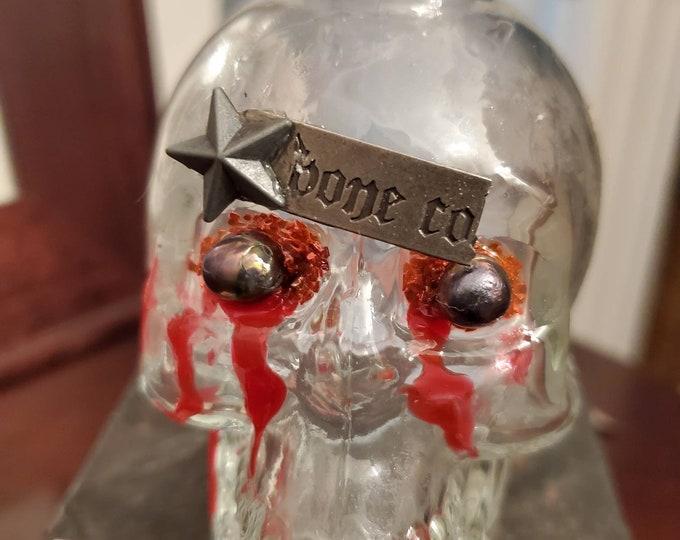 """Bone Co. Glass skull poison bottle design """"skinned"""""""