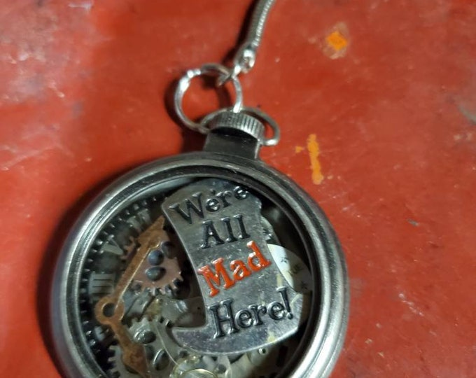 The mad hatters pocketwatch keychain Were all mad here