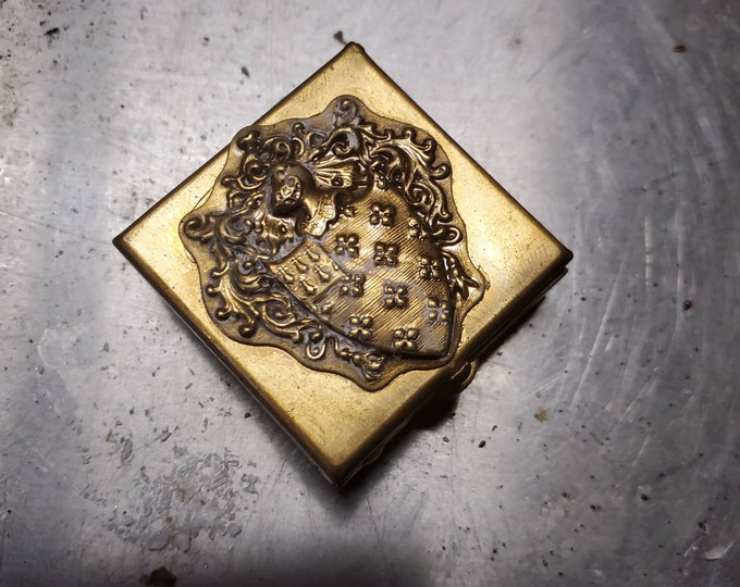 Mini vintage style brass pill box with coat of arms