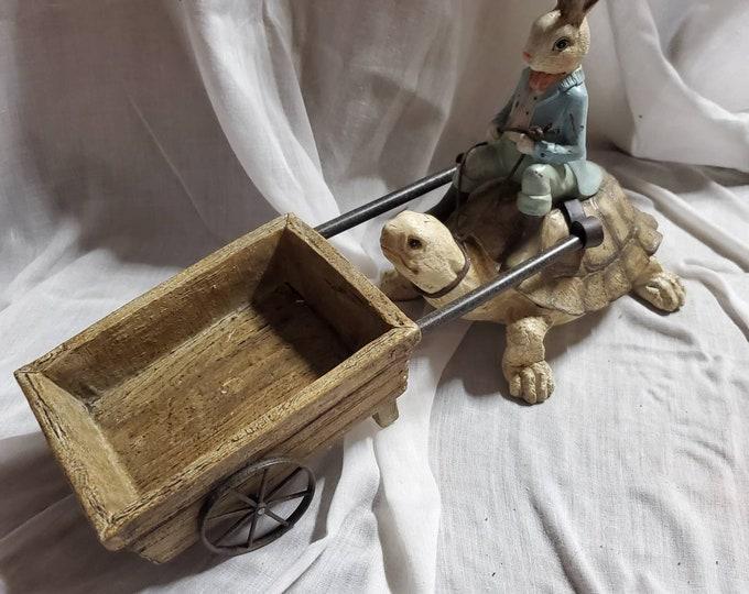 Wonderland vintage looking rabbit, turtle, and cart statue