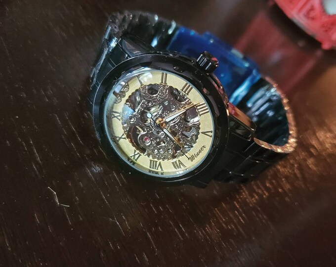 Gold and black steampunk wrist watch